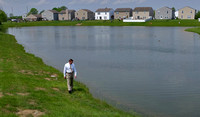 Retention pond barriers draw mixed reaction