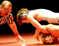 Cubs wrestler, coach weighing decision