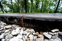 Rain damages 2 county roadways
